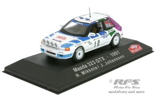 Mazda 323 GTX - Rallye Monte Carlo 1991<br />Hannu Mikkola / Johnny Johansson  -  # 10<br />1:43 - Atlas Collections - AL EAC1991MC10